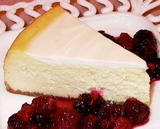 Cheese Cake #18 (Sliced with Warm Berry Sauce